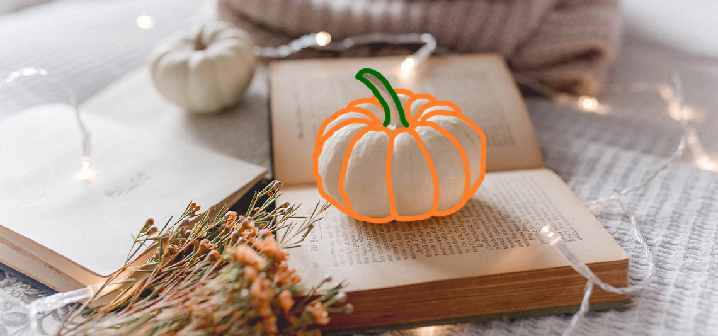 image of a pumpkin on a book