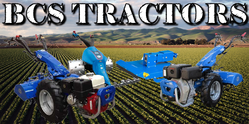 A display of different BCS Tractors and a couple attatchments